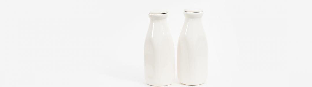 White milk bottles with a white background
