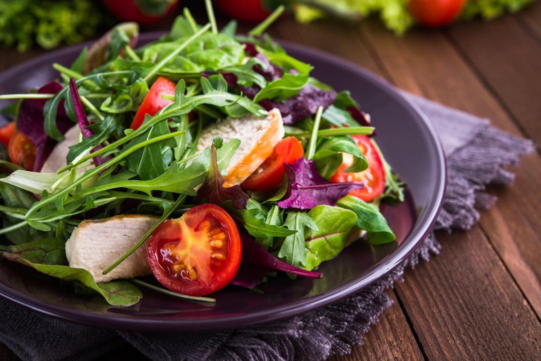 Beautiful salad on purple plate