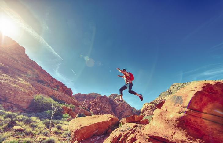 Person jumping in the desert