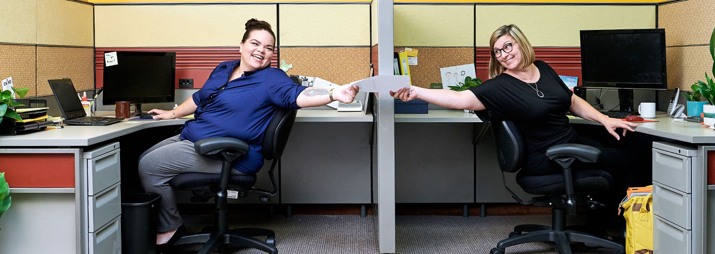 two women sitting in an office