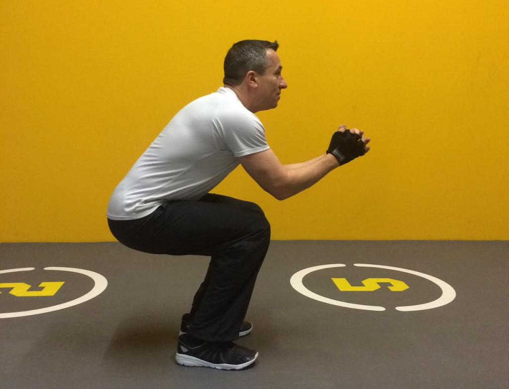 Man doing air squats